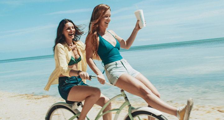 Two women on a bike