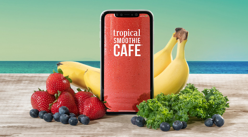 A mobile phone with the Tropical Smoothie Cafe app loaded.
