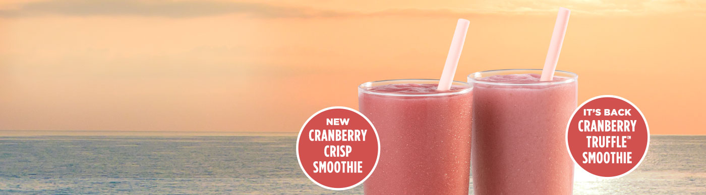 New Cranberry Crisp Smoothie and Cranberry Truffle Smoothie in front of a sea-scape sunset.